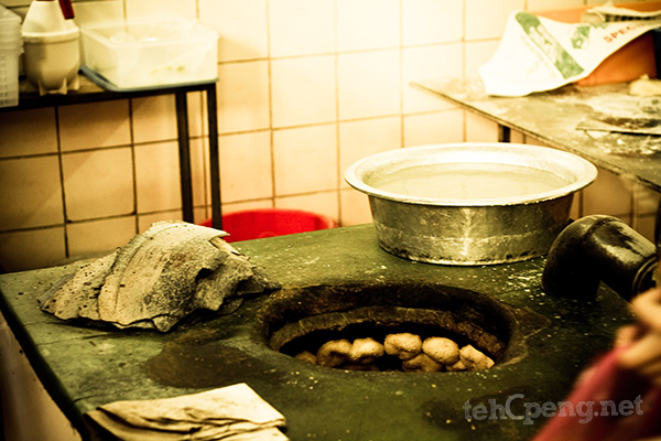 Fresh batches of kompiah in a traditional oven